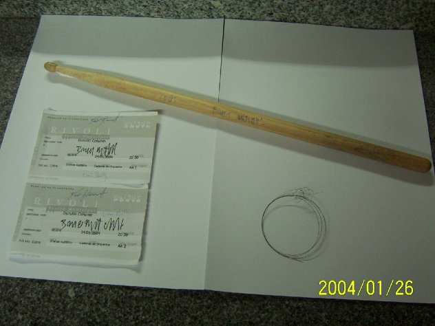 The Durutti Column live at Teatro Rivoli, Porto, Portugal 24 January 2004; detail of Bruce Mitchell's signed drumstick, Vini Reilly's broken guitar string and two signed tickets to the show