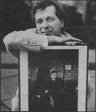 Anthony H Wilson with portrait of Ian Curtis